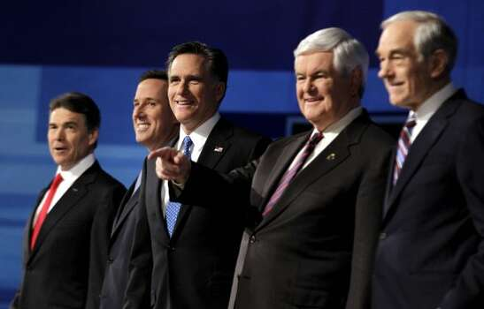 Rick Perry, Rick Santorum, Mitt Romney, Newt Gingrich and Ron Paul pose for a photo at the start of the South Carolina Republican presidential candidate debate Monday, Jan. 16, 2012, in Myrtle Beach, S.C. (David Goldman / Associated Press)
