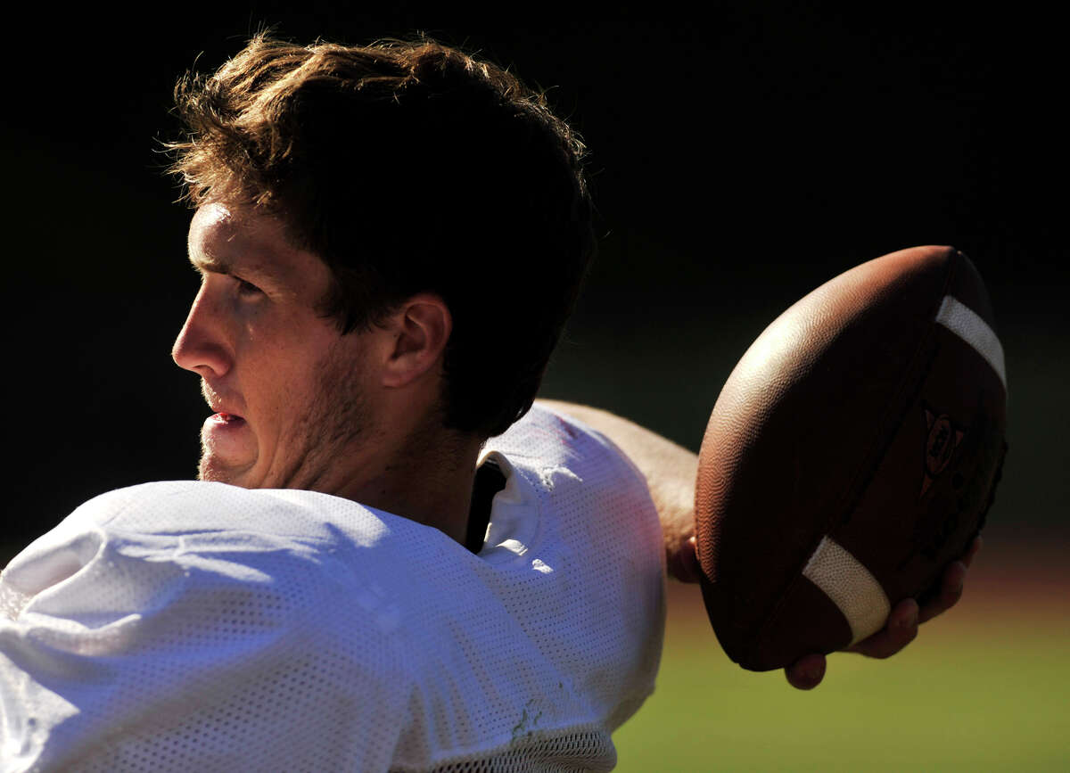 Eric Beatty throws the ball during Pomperaug High School football practice in Southbury on Wednesday, Aug. 29, 2012.