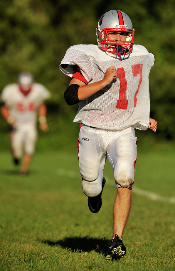Carl Gatzendorfer runs drills during Pomperaug High School football practice in Southbury on Wednesday, Aug. 29, 2012. Photo: Jason Rearick / The News-Times