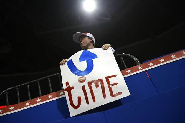 A convention goer holds up a sign at the Tampa Bay Times Forum in Tampa, Florida, on August 29, 2012 during the Republican National Convention (RNC). The RNC will culminate on August 30th with the formal nomination of Mitt Romney and Paul Ryan as the GOP presidential and vice-presidential candidates in the US presidential election. Photo: Brendan Smialowski, AFP/Getty Images