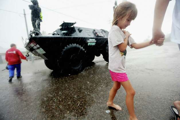 SLIDELL, LA - AUGUST 30:  Angelina Jordan holds her mother's hand after they were rescued in a Slidell Police Department SWAT vehicle from flooding from Hurricane Isaac's storm surge on the north shore of Lake Ponchartrain on August 30, 2012 in Slidell, Louisiana. The large Category 1 hurricane had slowly moved across southeast Louisiana, dumping huge amounts of rain and knocking out power to Louisianans in scattered parts of the state. The weather system has now been downgraded to a tropical storm but is still producing heavy rains and flooding as it moves north. Photo: Mario Tama, Getty Images / 2012 Getty Images