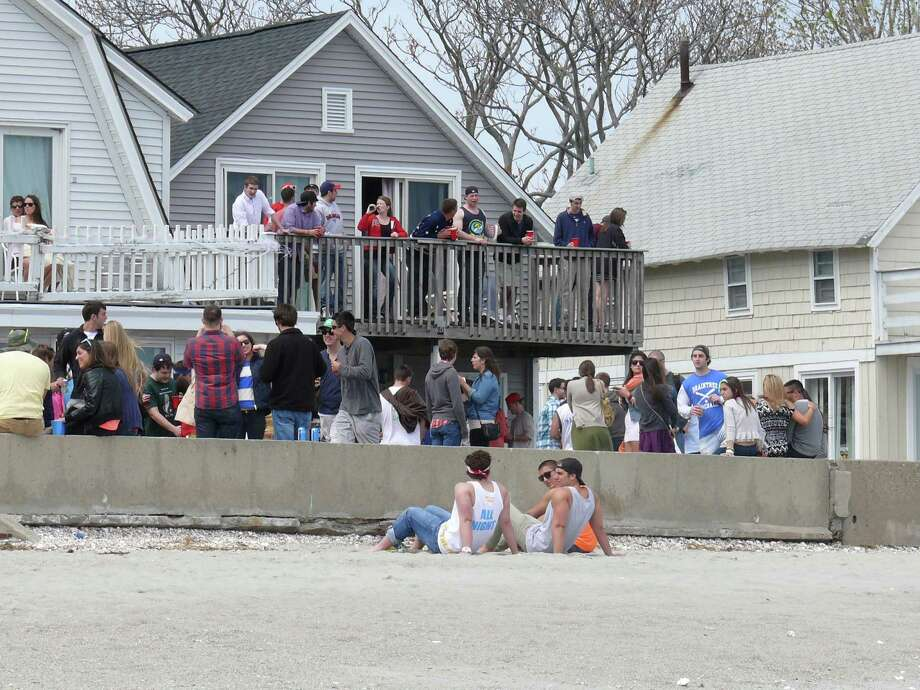 "The behavior of college students who rent beach houses has long been a concern of year-round beach-area residents. With new controls in effect this past spring, the crowd at the students' annual ""Clam Jam"" shrunk significantly. Photo: Genevieve Reilly, File Photo / Fairfield Citizen"