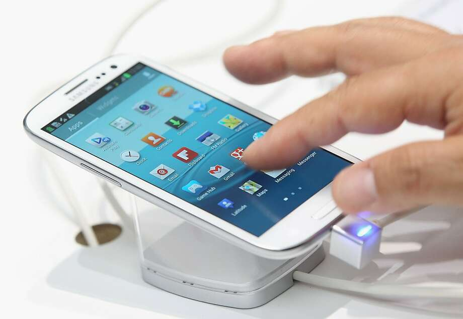 Apple's iPhone 5 must more than match Samsung's Galaxy S III if it doesn't want to be overrun by Android devices. Photo: Sean Gallup, Getty Images