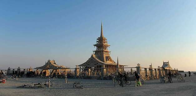 People gather at the temple on Wednesday morning at Burning Man on the Black Rock Desert near Gerlach, Nev. on Aug. 29, 2012. Photo: And