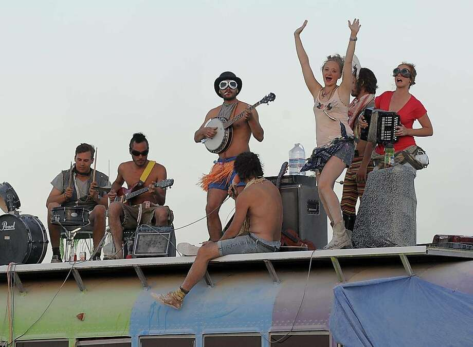 A band play music on top of a bus at Burning Man near Gerlach, Nev. on Aug. 28, 2012. Photo: Andy Barron, Associated Press
