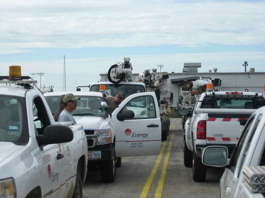 Entergy Texas rolling stock, including off-road, yard, pickups and bucket trucks -- 42 pieces in all, begin to depart the utility's service center on 11th Street with Baton Rouge as their destination to restore power to more than 700,000 people after Hurricane Isaac passed through. Photo: Dan Wallach