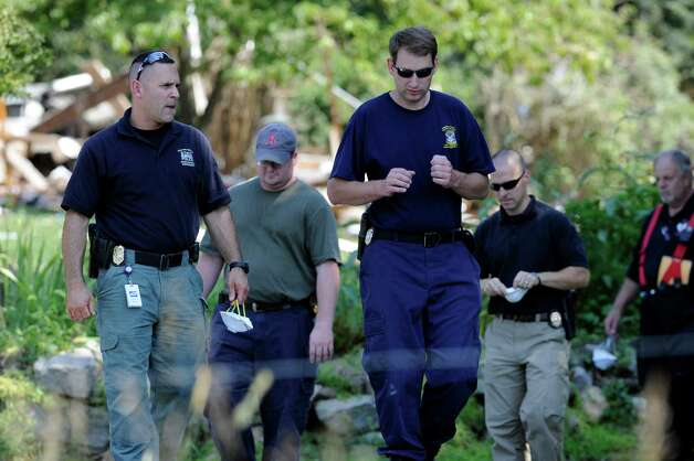 Investigators were at the scene, Thursday, Aug. 30, 2012, of a propane explosion that leveled a house on Sunny Valley Road in New Milford, Wednesday evening. Photo: Carol Kaliff