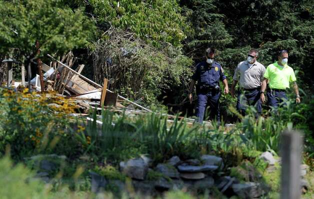 Investigators are at the scene Thursday, Aug. 30, 2012, of a propane explosion that leveled a home on Sunny Valley Road in New Milford Wednesday evening. Photo: Carol Kaliff