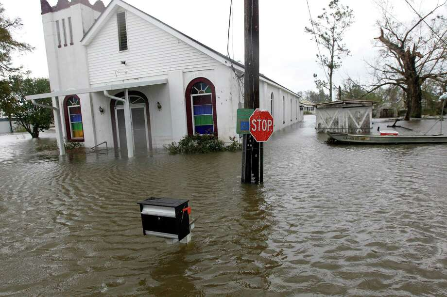 The St. Paul Missionary Baptist Church is seen flooded after Isaac passed through the region, in Plaquemines Parish, La., Thursday, Aug. 30, 2012.  Isaac staggered toward central Louisiana early Thursday, its weakening winds still potent enough to drive storm surge into portions of the coast and the River Parishes between New Orleans and Baton Rouge. (AP Photo/Gerald Herbert) Photo: Gerald Herbert, Associated Press / AP