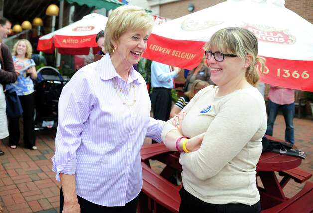 Republican Senate nominee Linda McMahon talks with Liz Kurantowicz, of Fairfield, while campaigning in Fairfield with State Senate Republican Leader John McKinney Wednesday, August 15, 2012. Photo: Autumn Driscoll / Connecticut Post