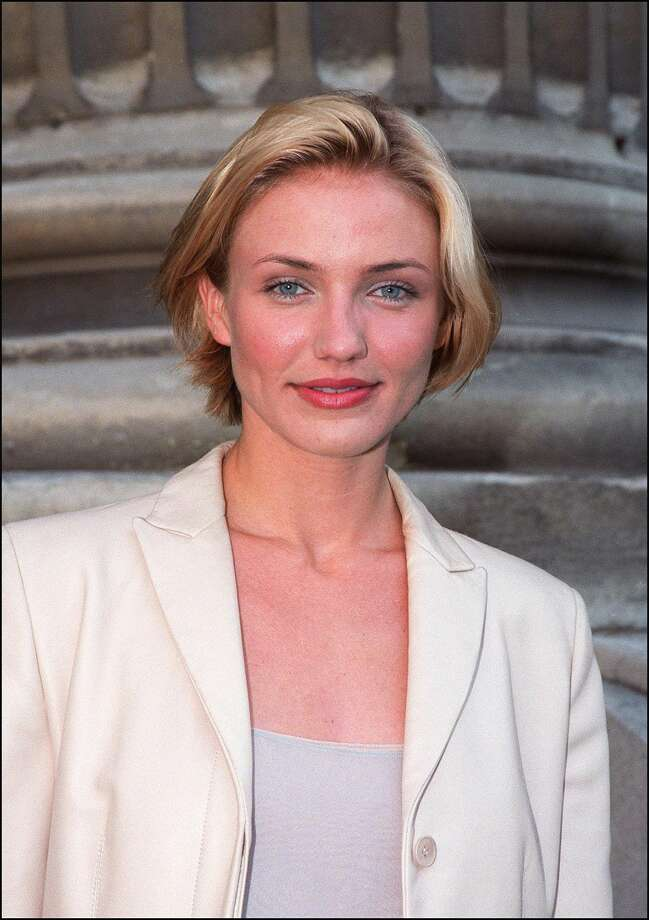 Actress Cameron Diaz poses for photographers at the opening of a Man Ray exhibition in Paris April 28.  (AFP/Getty Images)
