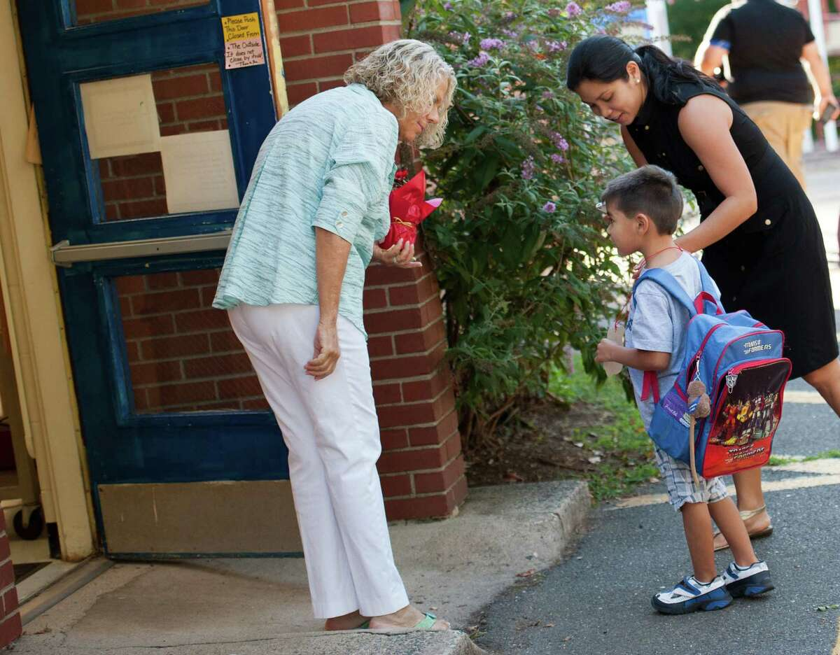 A floral arrangement in hand, Holland Hill kindergarten teacher Fran Wilder was outside greeting her new students on the first day of school Thursday.