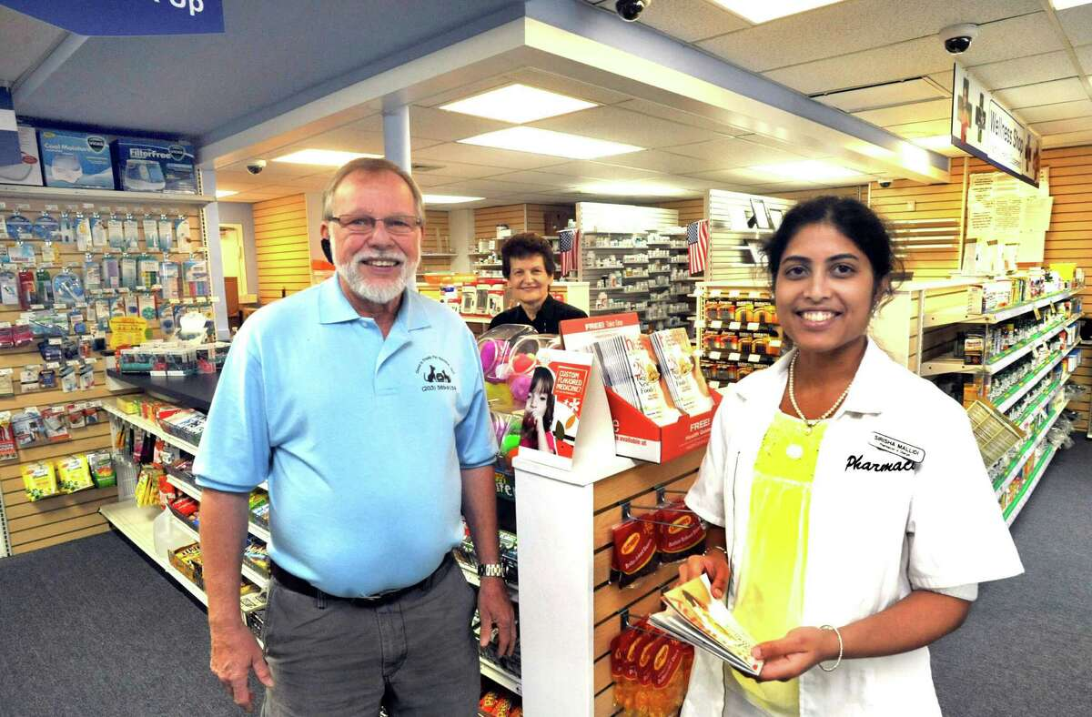 From left customer Eugene Rosen and pharmacy associate Vicki Karavitis stand in Newtown Pharmacy & Surgicals with pharmacist Sirisha Mallidi Monday, Aug. 20, 2012.