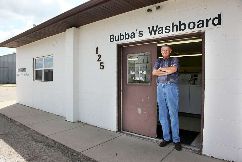 Richard Eggers stands at a Laundromat in Carlisle, Iowa, where he was arrested 49 years ago for putting a cardboard cutout of a dime in a laundry machine. Photo: Andrea Melendez, Associated Press
