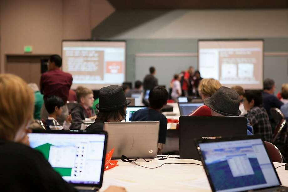 Players participate in a hackathon at the ROBLOX Game Conference at the Santa Clara Convention Center July 14. Hackathons, once the province of Silicon Valley geeks, are branching out to other professions. Photo: -, Courtesy Of ROBLOX