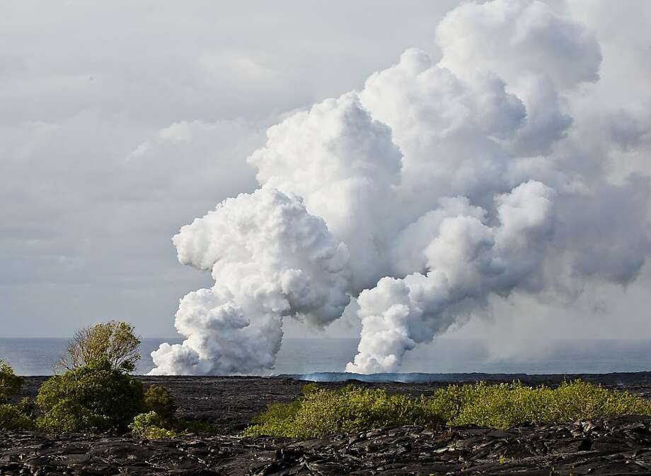 Kilauea's volcanic activity - whether plumes of smoke and ash or lava flowing into the sea - can often be seen from the official county viewing area in Kalapana. Photo: Tor Johnson, HTA