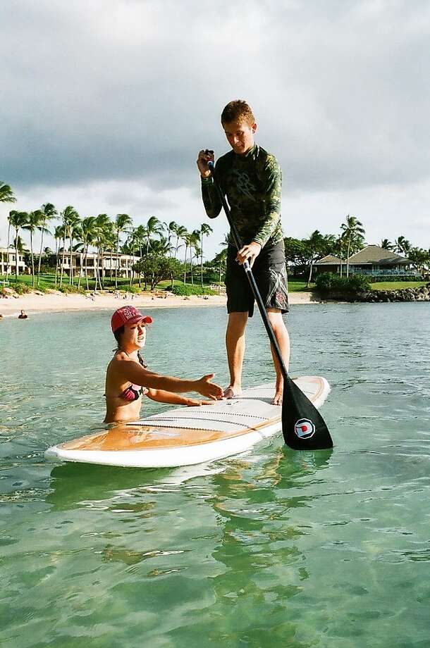 Tiki Man Stand Up Paddle now offers private and group lessons in Maui's Kapalua and Napili bays. Rates start at $90 per person for 90 minutes. Photo: Tiki Man SUP