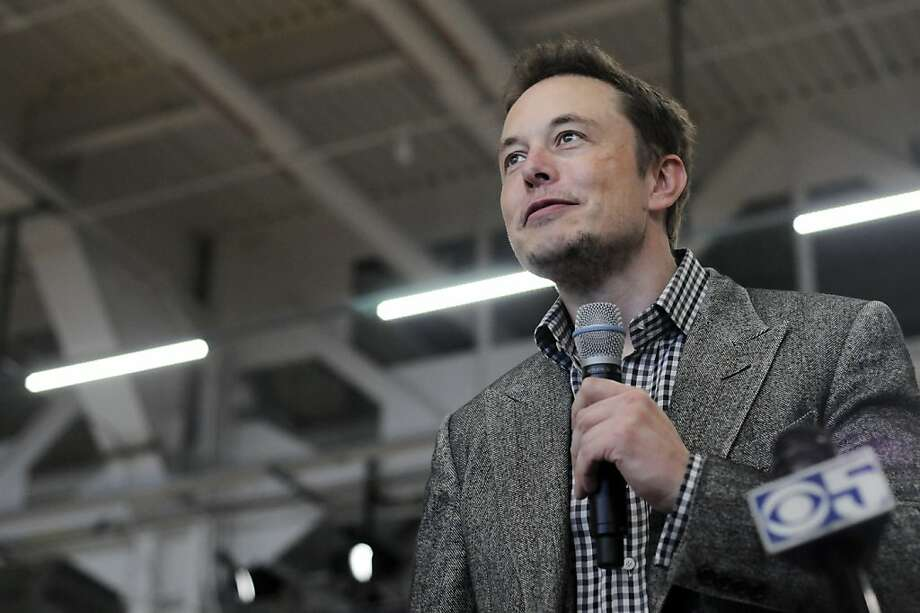 Tesla CEO Elon Musk speaks at the Tesla factory in Fremont, Calif., during an event to celebrate the release of the new Model S car Friday, June 22, 2012. It is only the second car ever produced by Tesla, and first to be built at Tesla's own factory. Photo: Erik Verduzco, Special To The Chronicle
