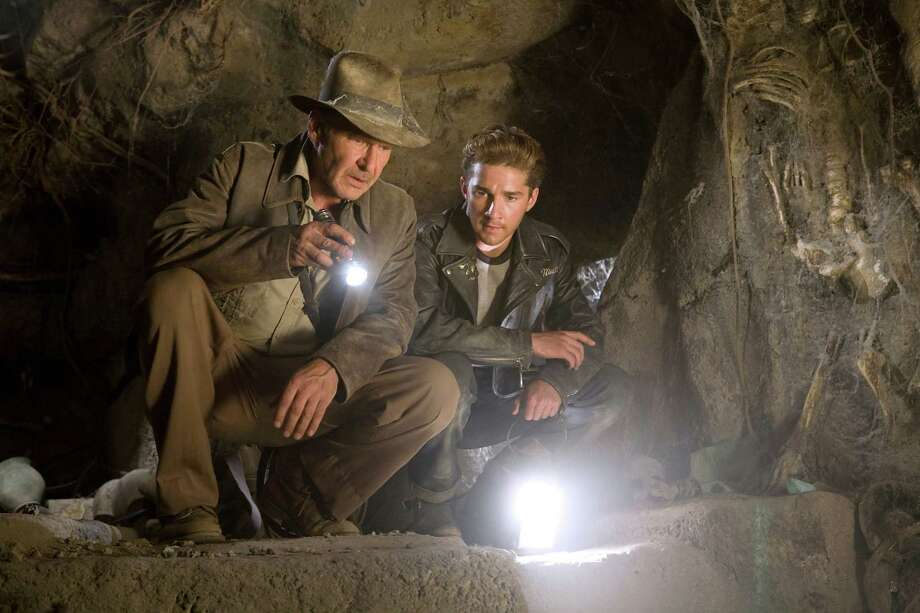 "This photo released by Paramount Pictures shows actors, from left, Harrison Ford as Indiana Jones, and Shia LaBeouf in a scene from ""Indiana Jones and the Kingdom of the Crystal Skull."" (AP Photo/Paramount Pictures, David James) ** NO SALES ** Photo: David James / PARAMOUNT PICTURES"