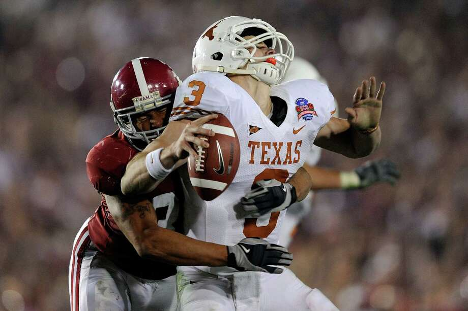 Quarterback Garrett Gilbert #3 of the Texas Longhorns fumbles the ball as he is hit by linebacker Eryk Anders #32 of the Alabama Crimson Tide during the Citi BCS National Championship game at the Rose Bowl on January 7, 2010 in Pasadena, California.  (Photo by Kevork Djansezian/Getty Images) *** Local Caption *** Garrett Gilbert;Eryk Anders Photo: Kevork Djansezian, Getty Images / 2010 Getty Images