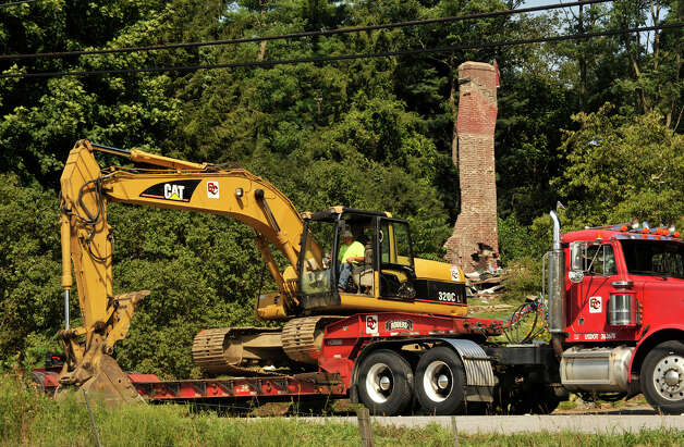 An excavator is brought onto the scene Thursday, Aug. 20, 2012, where a home on Sunny Valley Road, New Milford, exploded Wednesday evening. Photo: Jason Rearick / The News-Times