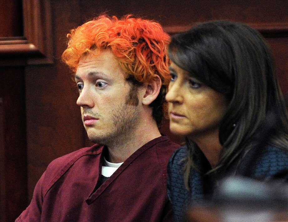 FILE - In this Monday, July 23, 2012 file photo, James Holmes, accused of killing 12 people in Friday's shooting rampage in an Aurora, Colo., movie theater, appears in Arapahoe County District Court with defense attorney Tamara Brady in Centennial, Colo. A court hearing Thursday, Aug. 30, 2012 will examine Holmes' relationship with a University of Colorado psychiatrist to whom he mailed a package containing a notebook that reportedly contains violent descriptions of an attack. His attorneys say Holmes is mentally ill and that he sought help from psychiatrist Lynne Fenton at the school, where he was a Ph.D. student, until shortly before the July 20 shooting. Prosecutors allege Holmes may have been angry at the failure of a once promising academic career.  (AP Photo/Denver Post, RJ Sangosti, Pool, File) Photo: RJ Sangosti / Pool Denver Post