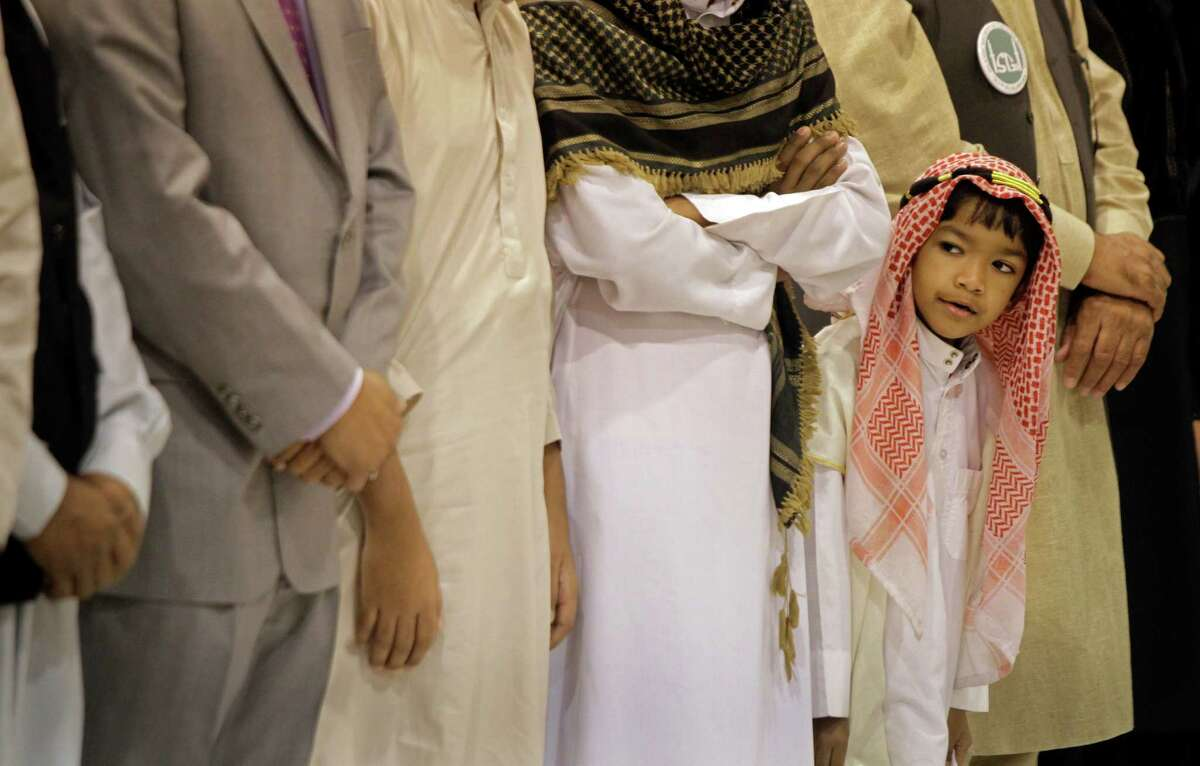 Zaafir Bin Anowar, 6, takes part in an Eid prayer event hosted by the Islamic Society of Greater Houston. A survey has found generational and political differences in how Americans view Muslims.