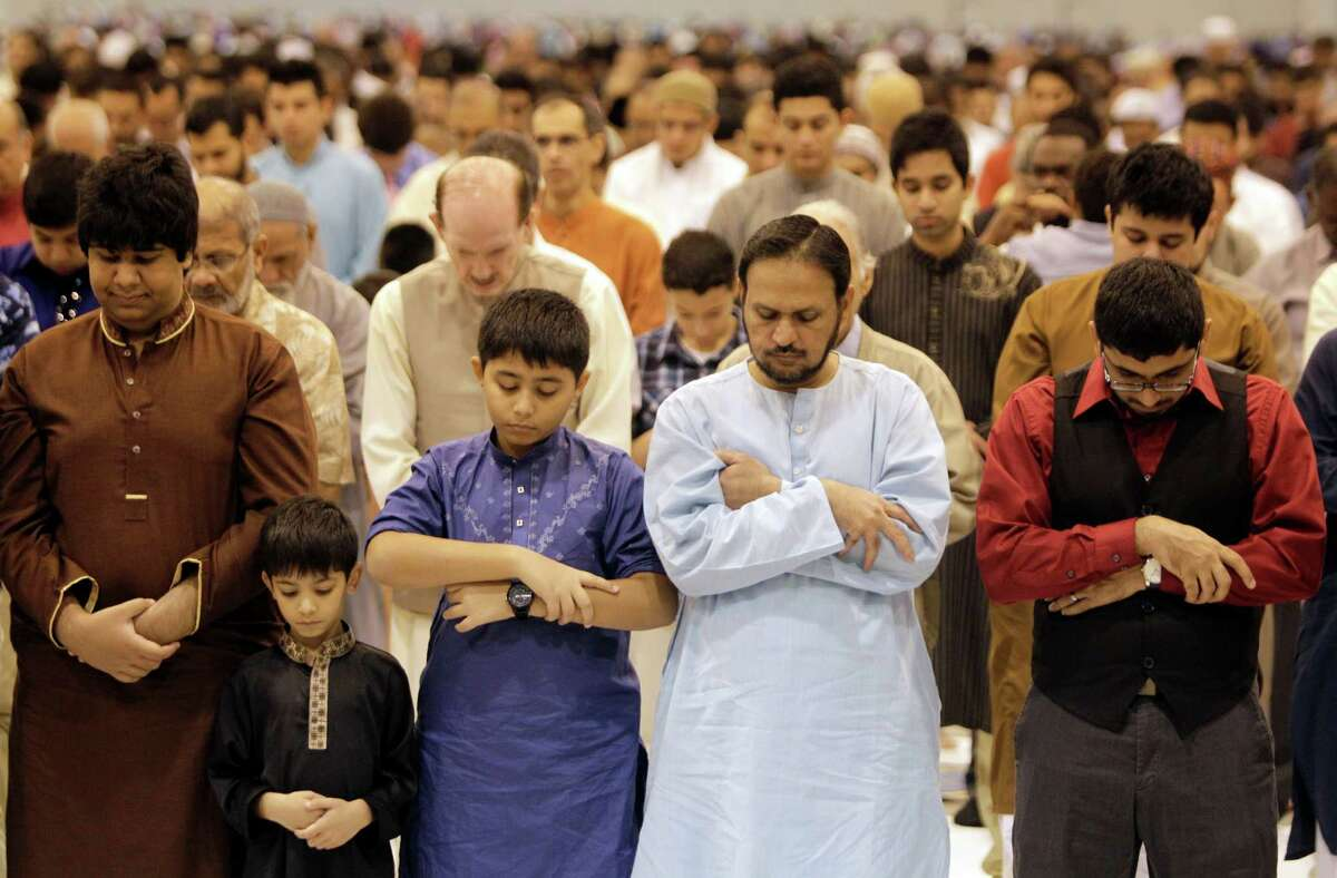Crowd prays during an Eid prayer event hosted by the Islamic Society of Greater Houston at Reliant Center, Sunday, Aug. 19, 2012, in Houston. Eid is the Muslim holiday that signals the end of the month of fasting known as Ramadan. ( Melissa Phillip / Houston Chronicle )