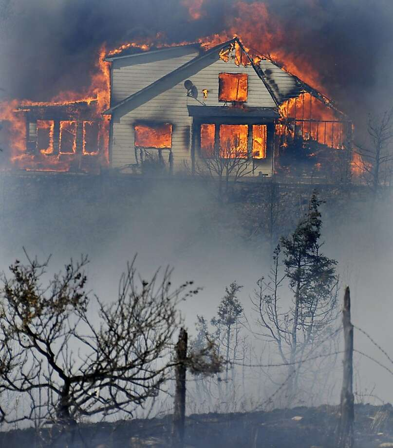 A home burns just north of East River Road during the Pine Creek Fire in Paradise Valley near Pine Creek Wednesday, Aug. 29, 2012 in Livingston, Mont..  Photo: Shawn Raecke, Associated Press