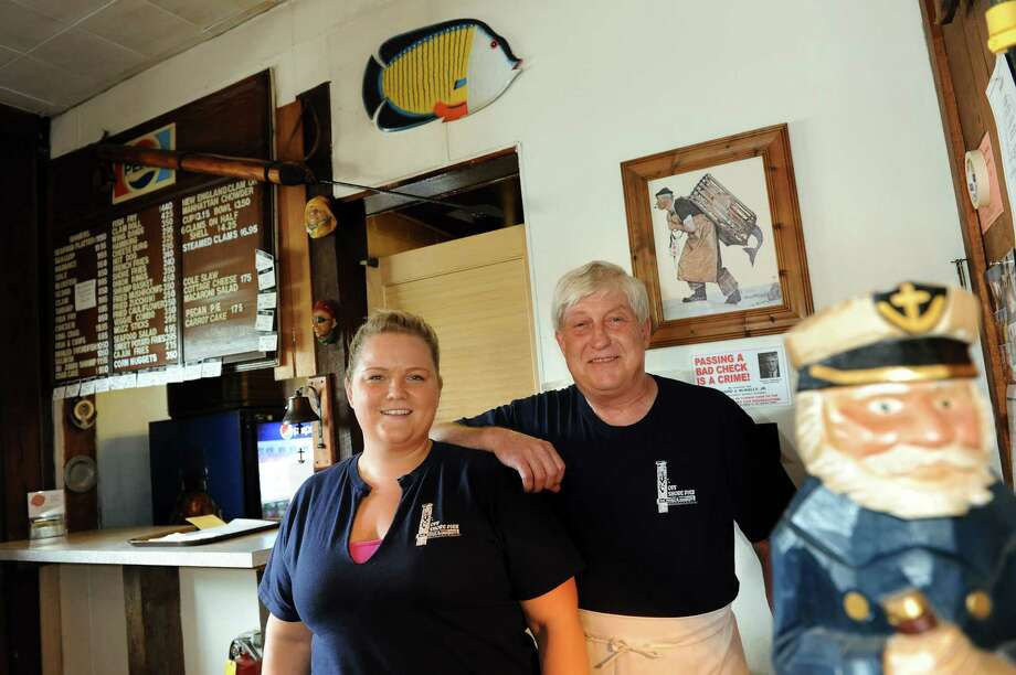Owner David Meisner, right, and his daughter, Rachel, who's worked at the restaurant from the age of 12, on Tuesday, Aug. 28, 2012, at Off Shore Pier Restaurant in East Greenbush, N.Y. (Cindy Schultz / Times Union) Photo: Cindy Schultz / 00019039A