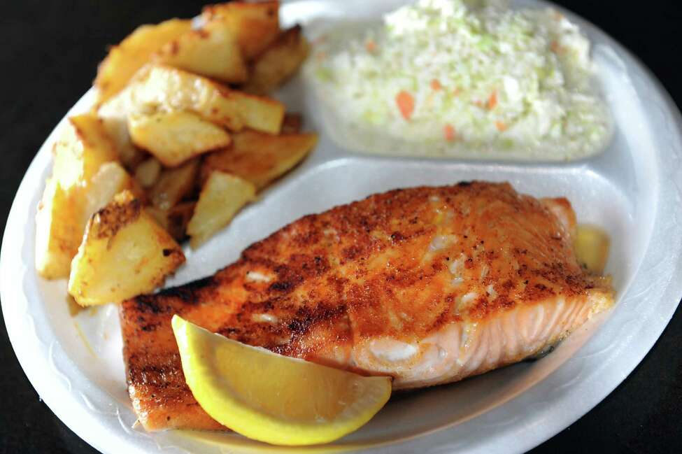 Broiled salmon with shore fries and coleslaw on Tuesday, Aug. 28, 2012, at Off Shore Pier Restaurant in East Greenbush, N.Y. (Cindy Schultz / Times Union)