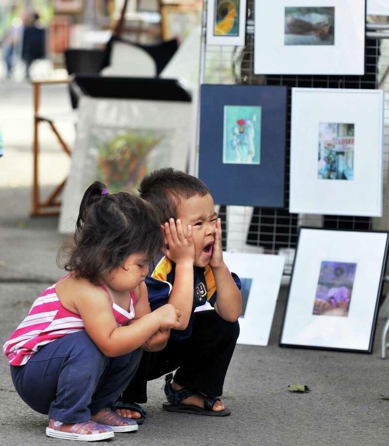 Concetta,2, and Hainuo,3, Hodgkins of Schenectady at the Schenectady Stockade Outdoor Art Show in Schenectady Saturday  Sept. 10, 2011.   (John Carl D'Annibale / Times Union) Photo: John Carl D'Annibale / 00014169A