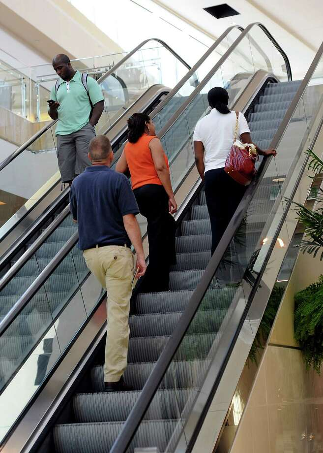 We are a city primarily of standers, as an escalator at the Galleria demonstrated earlier this month. Photo: Dave Rossman / © 2012 Dave Rossman