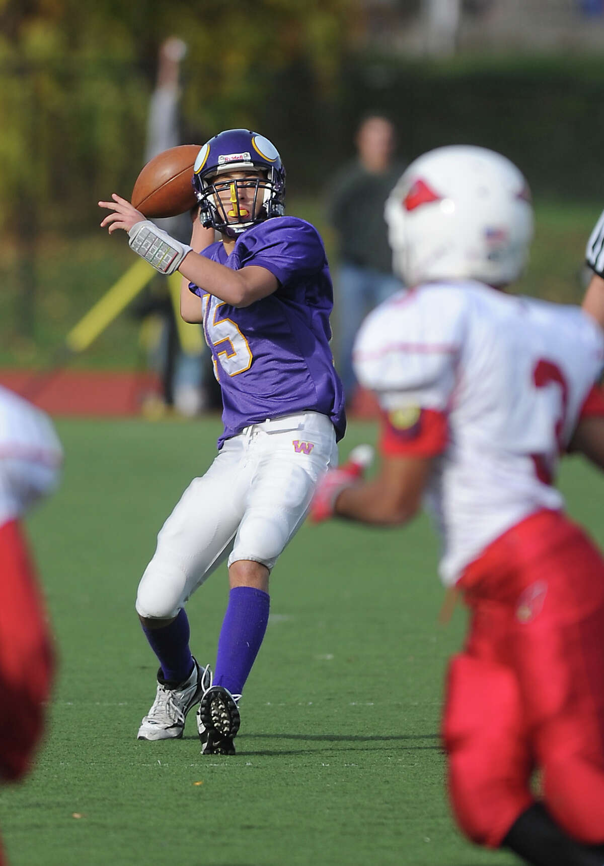 Westhill High School quarterback Peter Cernansky looks to throw against Greenwich High School in football action in Stamford, Conn. on Saturday October 30, 2010.