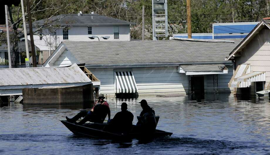 FILE - In this Sept. 7, 2005 file photo, a search and rescue squad uses a small boat in the floodwaters of the Ninth Ward in New Orleans. (AP Photo/Eric Gay, File) Photo: Eric Gay / AP