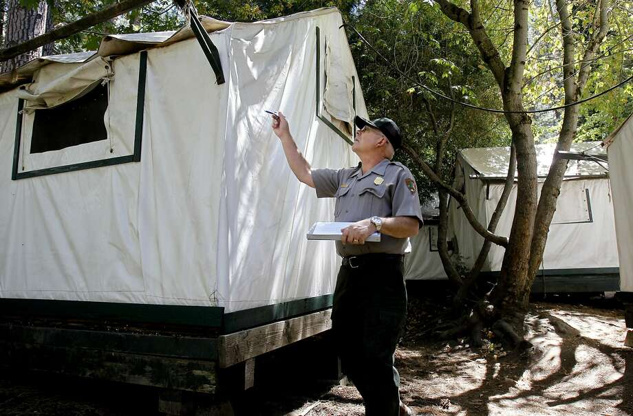 Glenn Dean, a National Parks Occupational Safety and Health Specialist inspects tent cabins for mice entry points at Curry Village at Yosemite National Park on Tuesday August 28, 2012. Four people have been infected with the hantavirus, two of which have died while staying at the Curry Village tent cabins at Yosemite National Park in California. Photo: Michael Macor, The Chronicle