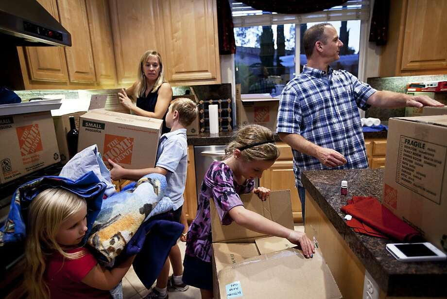 Erick and Nichole Ormsby, part of a rare group of move-up buyers, unpack with their three children, Taylor (left), Connor and Hannah. They moved into a bigger house in Danville after selling their San Ramon home. Photo: Sonja Och, The Chronicle