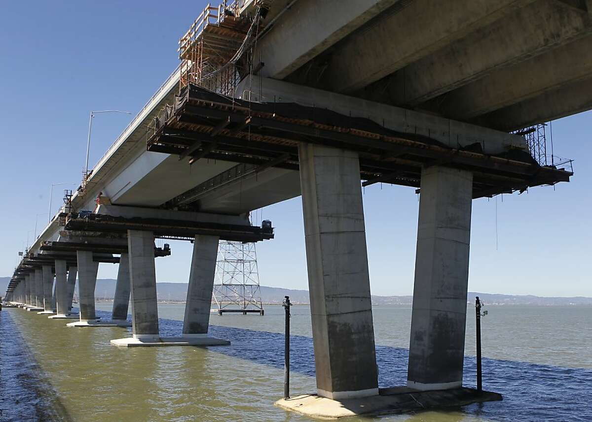 Construction crews work on a retrofit project below the Dumbarton Bridge in Fremont, Calif. on Tuesday, Aug. 28, 2012. Caltrans will close both directions of the span over the Labor Day weekend to install a seismic joint on the east end.