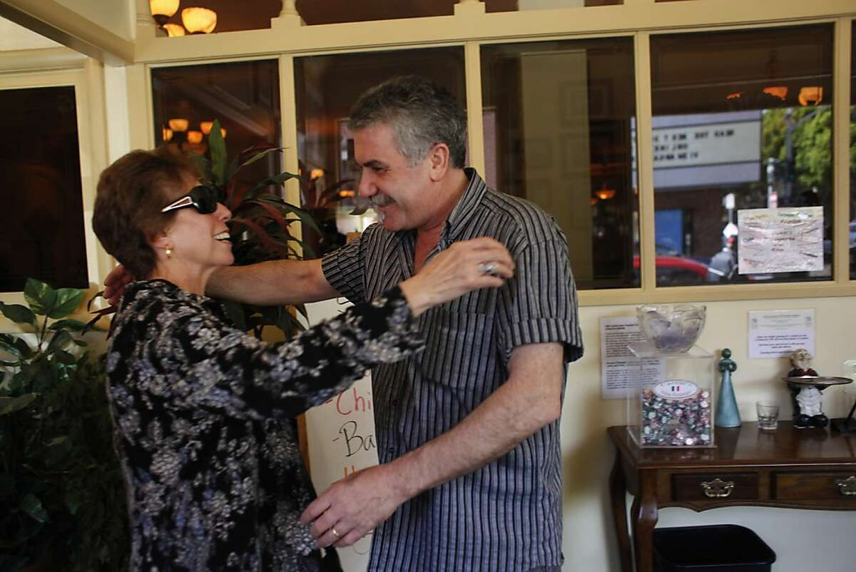 Grace Restivo (l to r) of San Jose and Matteo Crivello, co-owner Caesar's Italian Restaurant, greet each other with a hug as Restivo arrives with her family to have lunch at Caesar's Italian Restaurant on Thursday, August 30, 2012 in San Francisco, Calif.