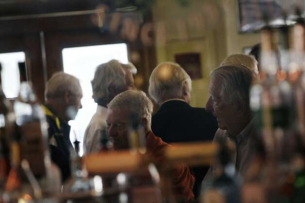 Patrons gathered at the bar at Caesar's Italian Restaurant are reflected in the mirror above the bar on Thursday, August 30, 2012 in San Francisco, Calif. Photo: Lea Suzuki, The Chronicle