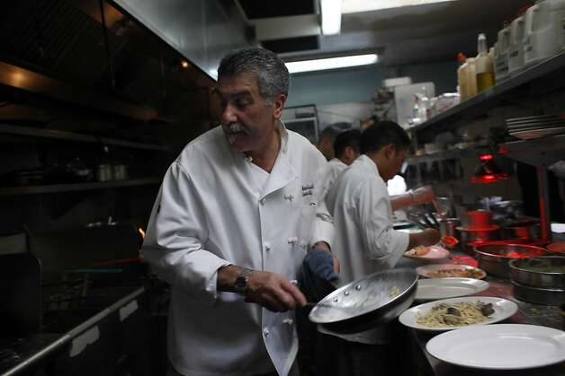 Co-owner Matteo Crivello (left) whips up a plate of linguini with white clam sauce in the kitchen at Caesar's Italian Restaurant  on Thursday, August 30, 2012 in San Francisco, Calif. Photo: Lea Suzuki, The Chronicle