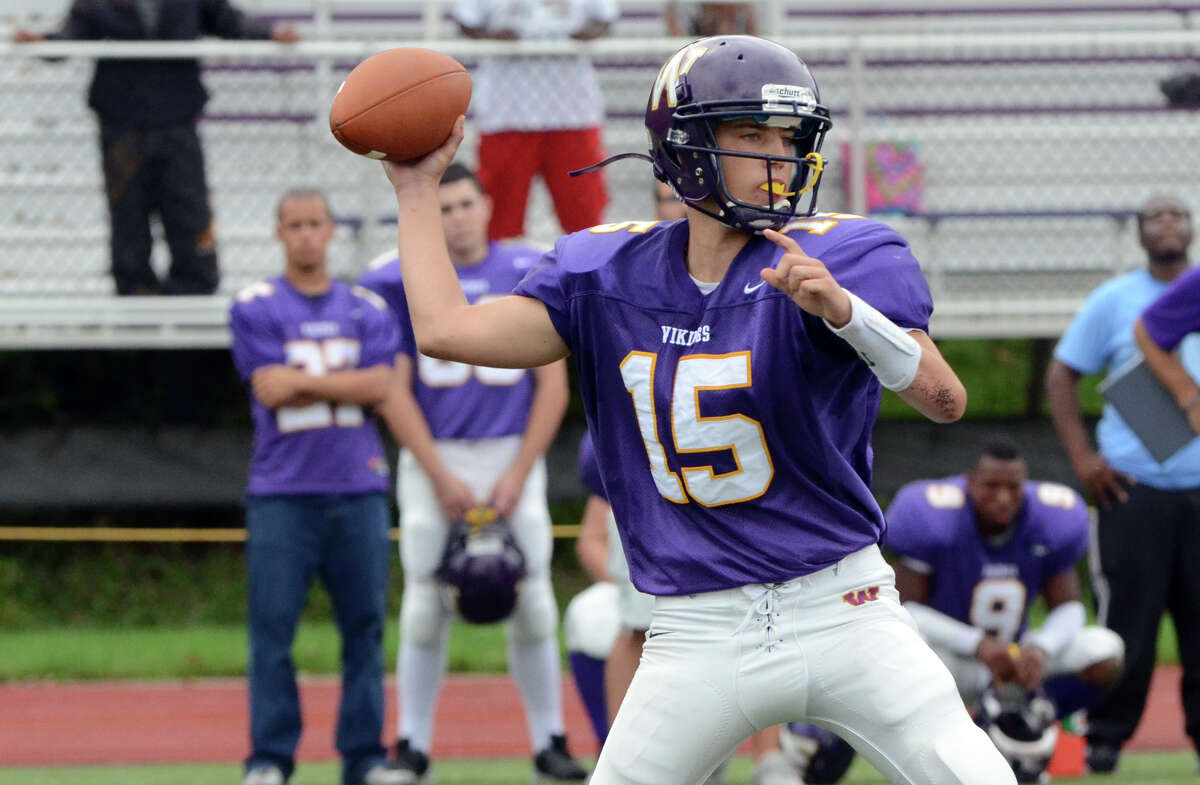 Westhill's Peter Cernansky looks to pass during the football game against Trumbull at Westhill High School in Stamford on Saturday, Sept. 24, 2011.