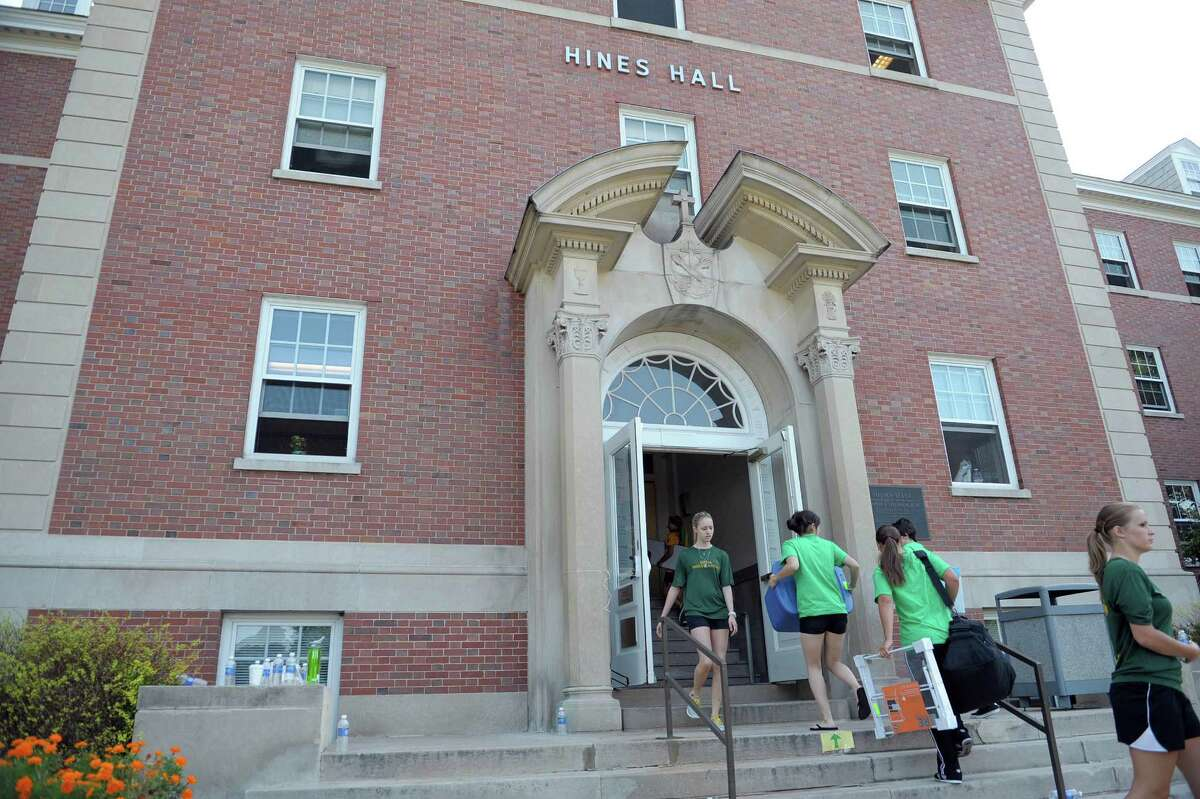 Siena College students who are orientation leaders, student ambassadors and members of the women's rugby team help to carry in the belongings of a new student during new student move in day on Thursday, Aug. 30, 2012 in Loudonville, NY. (Paul Buckowski / Times Union)