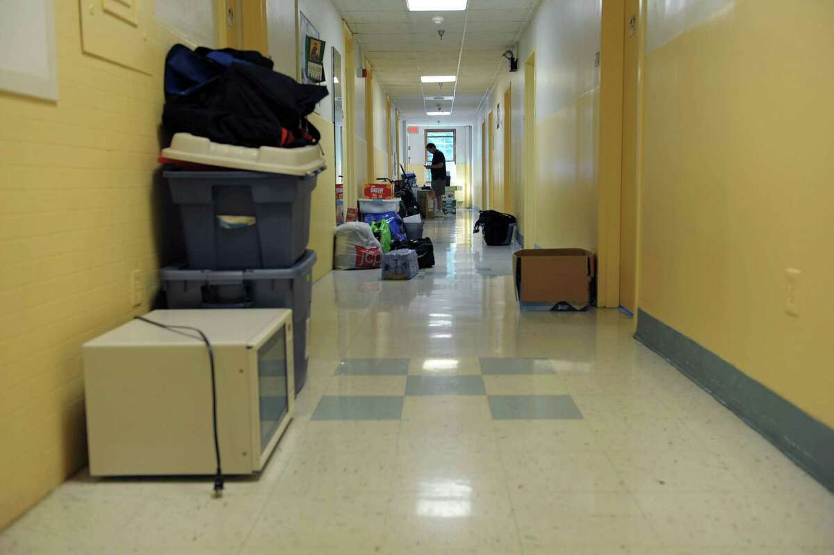 Items line the hallway in a freshman dorm during new student move in day on Thursday, Aug. 30, 2012 in Loudonville, NY. (Paul Buckowski / Times Union)