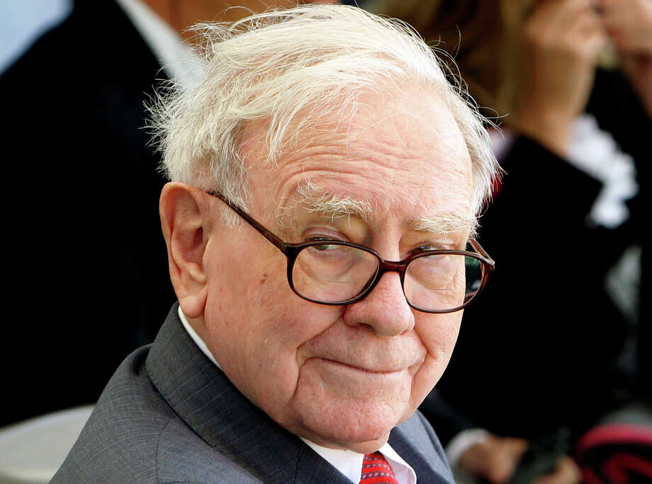 Buffett is worth an estimated $58.5 billion, according to Forbes.  Photo: Shuji Kajiyama / AP