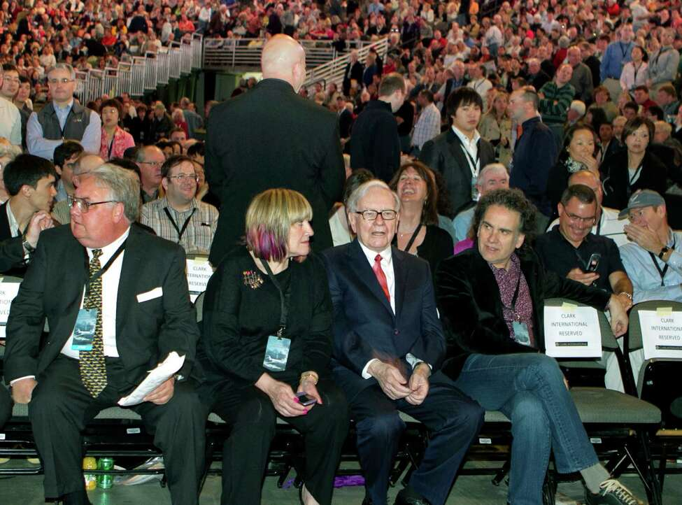 FILE- In this Saturday, April 30, 2011, file photo, Berkshire Hathaway Chairman and CEO Warren Buffett, second right, sits with his children from left: Howard, Susie and Peter, at the Berkshire Hathaway shareholders meeting in Omaha, Neb. Buffett is celebrating his 82nd birthday Friday, Aug. 31, 2012, by giving each of his three children a big present: about $600 million worth of his company's stock for their charitable foundation. (AP Photo/Nati Harnik, File)