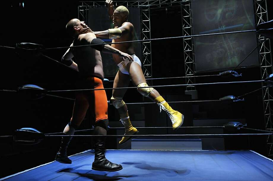 Chad Deity (Beethovan Oden, right) pummels the Bad Guy (Dave Maier) in Aurora Theatre's satiric look at pro wrestling. Photo: David Allen