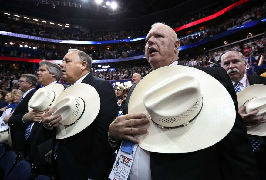 TAMPA, FL - AUGUST 30:  Members of the Texas delegation hold their cowboy hats on their chests durin