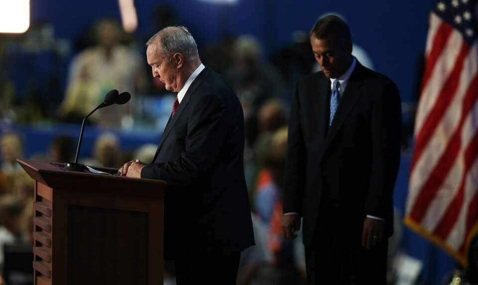 TAMPA, FL - AUGUST 30:  Ken Hutchins (L) gives the invocation as U.S. Speaker of the House Rep. John