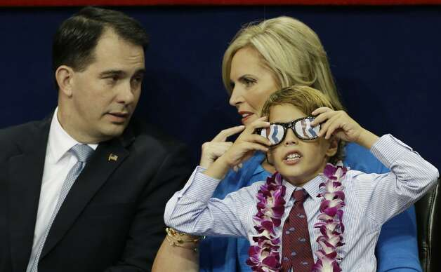 Ann Romney, wife of U.S. Republican presidential nominee Mitt Romney, talks to Wisconsin Governor Scott Walker with one of her grandsons during the Republican National Convention in Tampa, Fla., on Thursday, Aug. 30, 2012. (AP Photo/Charlie Neibergall) (Charlie Neibergall / Associated Press)